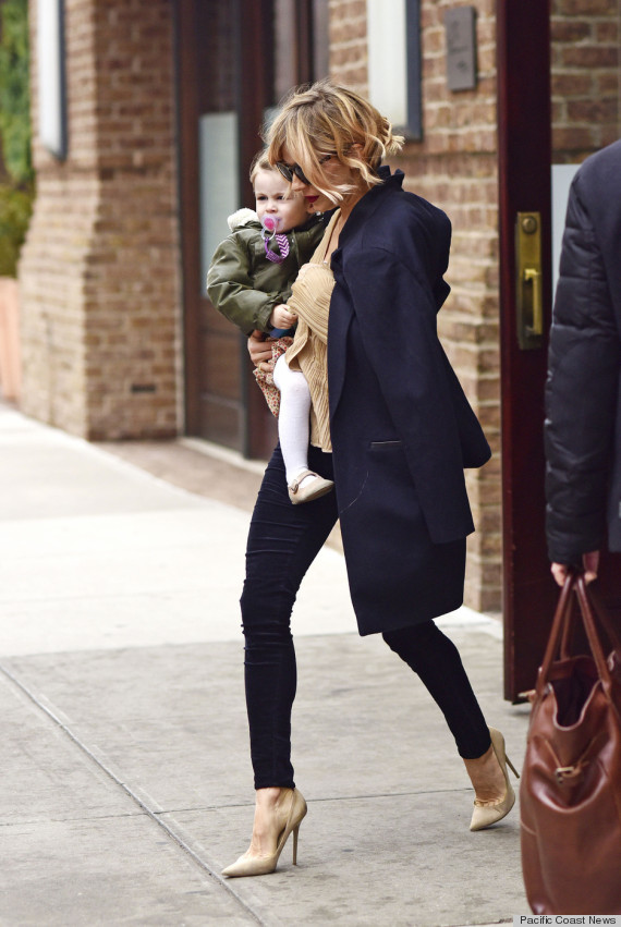 Sienna Miller carries baby Marlowe while checking out of The Greenwich Hotel in Tribeca, NYC